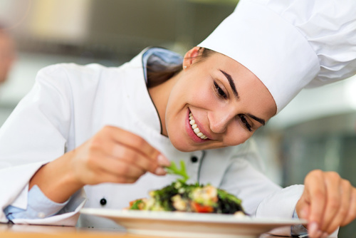 Female chef in kitchen